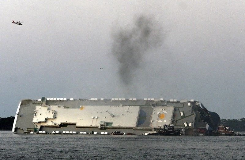 GEORGIA. Smoke rises from a cargo ship that capsized in the St. Simons Island, Georgia sound Sunday, September 8, 2019. (AP)