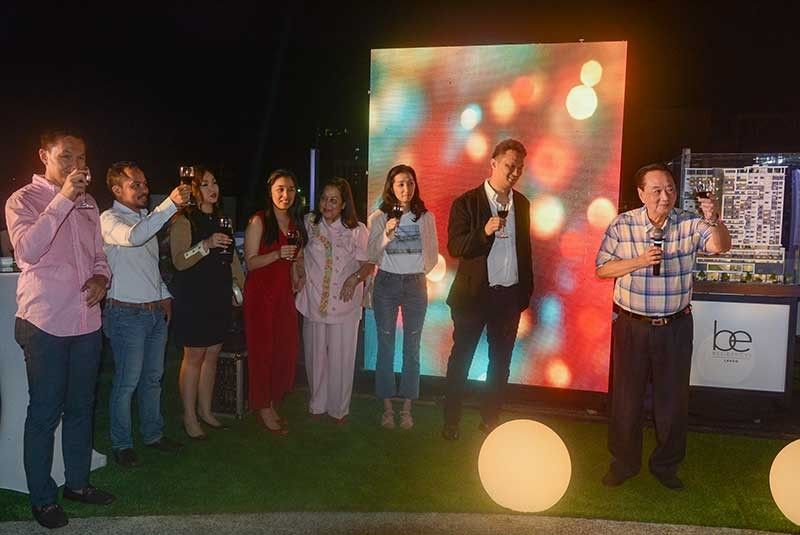 START OF SOMETHING NEW: Enrique Benedicto (right), chairman of Enrison Holdings Inc., leads the ceremonial toast of the family's new real estate venture—Be Residences— a 700-unit condo tower to be erected in Lahug, Cebu City. This is the family's first foray into the residential business. (SunStar Photo/Arni Aclao)