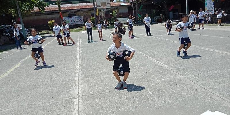 DAVAO. These kids have fun playing the football race during the Sports for Peace Children's Games held at Holy Cross of Malita, Davao Occidental on September 7. (PSC Mindanao)