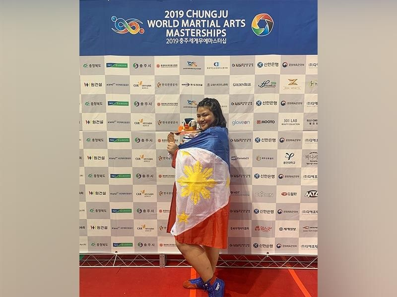 SOUTH KOREA. Sydney Sy Tancontian celebrates her bronze medal finish in the recently-concluded 2019 Chungju World Martial Arts Masterships in Chungju, South Korea.