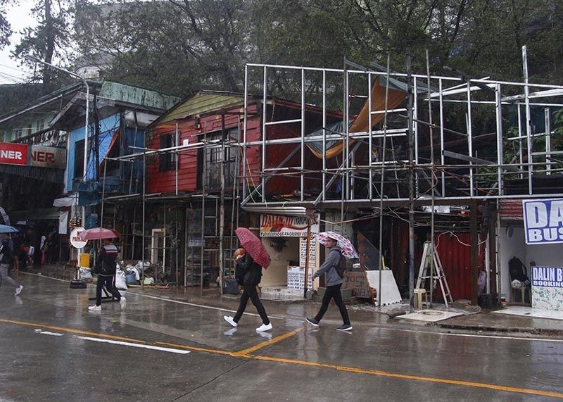 BAGUIO. Establishments obstructing the footpath along Governor Pack Road are being demolished. The government is strictly imposing the road right of way. (Photo by Jean Nicole Cortes)