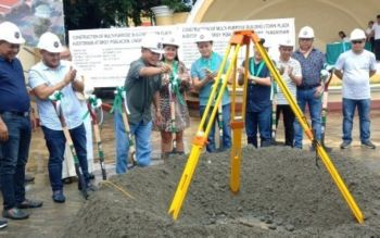 PANGASINAN. Lingayen Mayor Leopoldo Bataoil (third from left) lowers the time capsule for the planned town plaza auditorium that marks the start of construction for the project on Saturday (September 7, 2019) at Barangay Poblacion Lingayen Pangasinan. The groundbreaking ceremony was attended by other provincial officials. (PNA photo by Hilda Austria)