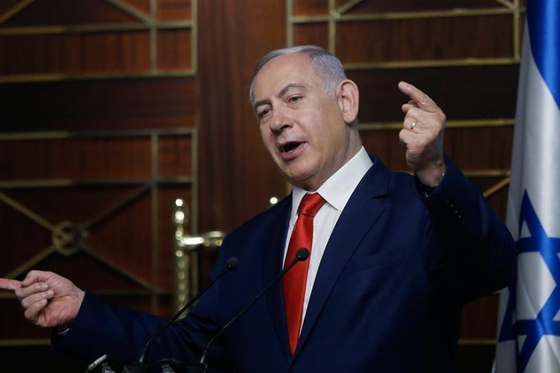 UKRAINE. In this Tuesday, August 20, 2019 file photo, Israeli Prime Minister Benjamin Netanyahu delivers a speech in Kyiv, Ukraine. The long shadow war between Israel and Iran has burst into the open in recent days, with Israel allegedly striking Iran-linked targets as far away as Iraq and crash-landing two drones in Lebanon. These incidents, along with an air raid in Syria that Israel says thwarted an imminent Iranian drone attack, have raised tensions at a particularly fraught time. (AP)