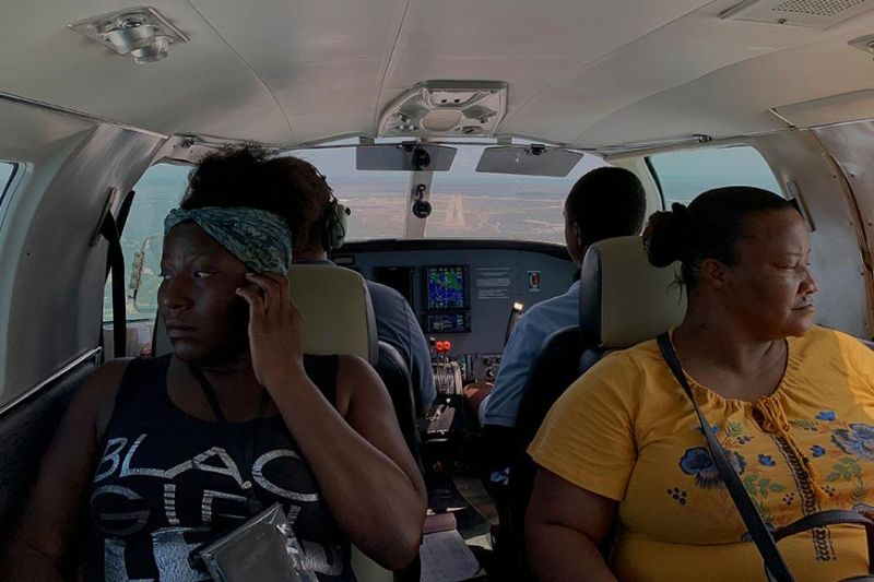 "NASSAU. Dimple Lightbourne (left) and her mother Carla Ferguson sit in a plane as it approaches to land in Nassau after they were evacuated from Abaco Island, in the Bahamas, Monday, September 9, 2019. ""We don't know where we're going to stay,"" said Ferguson, a 51-year-old resident of Treasure Cay. (AP)"