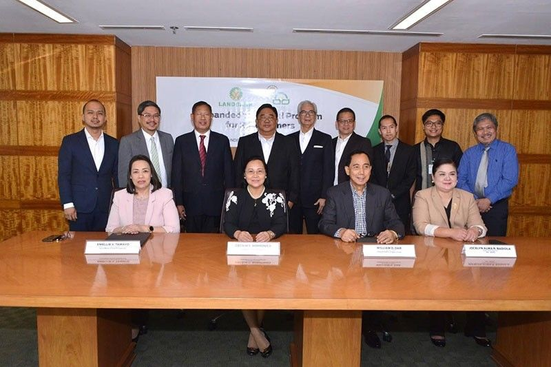AGREEMENT. Land Bank president and chief executive officer Cecilia C. Borromeo (seated, second from left) and Agriculture Acting Secretary William D. Dar (seated, third from left) sign a memorandum of agreement with LBP Lending Program Management Group head Emellie Tamayo (seated, leftmost) and Agricultural Credit Policy Council (ACPC) executive director Jocelyn Alma Badiola (seated, rightmost). Witnesses include Agrarian Reform Secretary John Castriciones (standing, fourth from left) with (standing, from left) deputy treasurer Erwin Sta. Ana, Land Bank directors Jesus Hinlo Jr., Jaime Miralles and Virgilio Robes Jr., Agriculture Undersecretary Francisco Villano Jr. and ACPC Deputy Executive Director Ramon Yedra (standing, rightmost). (Contributed Photo)