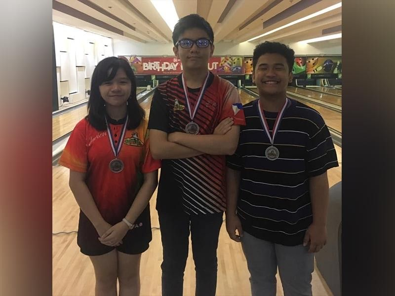 DAVAO. Third placer Marion Bermudez, champion Zachary Lorenzo Sulit and runner-up Clark Tancontian beam with pride after topping the recently-concluded Datba Youth Mini Tournament at SM Lanang Premier Bowling Center. (Ralph Martin Facebook)