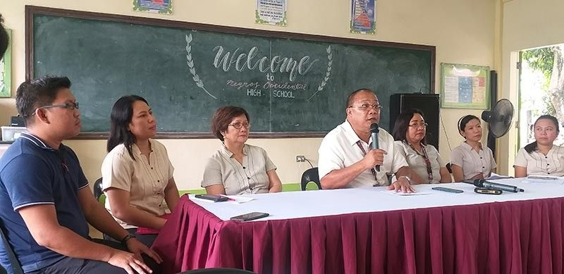 BACOLOD. Negros Occidental High School principal Mario Amaca (center) with science teachers in a press conference on their Science Month Celebration at the school in Bacolod City Tuesday, September 10, 2019. (Photo by Erwin P. Nicavera)