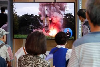 NORTH KOREA. People watch a TV showing a file image of a North Korea's missile launch during a news program at the Seoul Railway Station in Seoul, South Korea, Tuesday, September 10, 2019. North Korea launched at least two unidentified projectiles toward the sea on Tuesday, South Korea's military said, hours after the North offered to resume nuclear diplomacy with the United States but warned its dealings with Washington may end without new U.S. proposals. (AP)