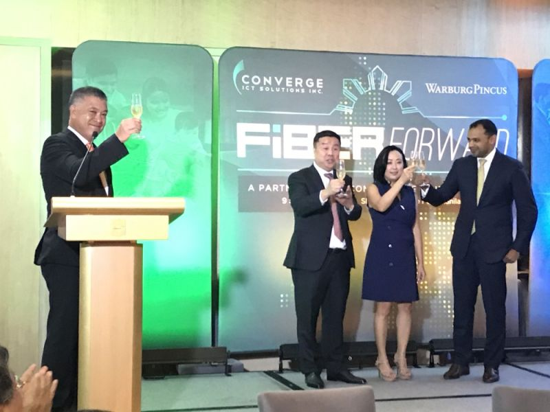 PAMPANGA. Converge ICT Chief Operating Officer shares a toast with President/CEO Dennis Anthony H. Uy, Grace Y. Uy, Chief Resource Officer and Saurabh Agrawal, Warburg Pincus managing director after the signing of an investment deal that infused $250 million dollars into Converge ongoing projects. (Contributed photo)