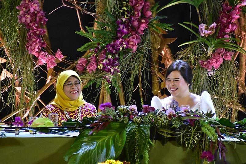 DAVAO. Singapore President Halimah Yacob having a light moment with Davao City Mayor Sara Duterte-Carpio during a dinner hosted by the City Government and held at Marco Polo Hotel. (Macky Lim)