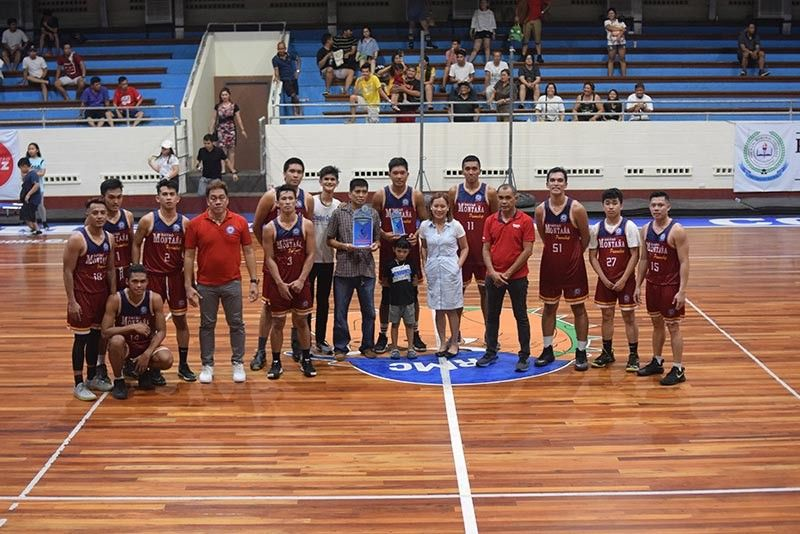 DAVAO. Montaña Pawnshop Pawnbrokers players, coaches and officials receive the champion's trophy in the recently-concluded first Mindanao Banana Farmers and Exporters Association (MBFEA) Basketball League held at the Rizal Memorial Colleges (RMC) Petro Gazz Arena. (Photo by Aldin Celi)