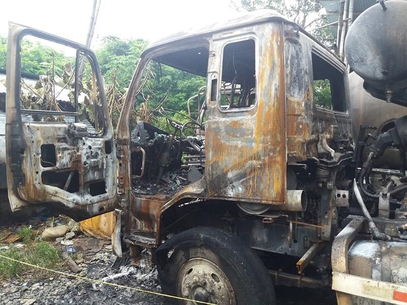 ILOILO. Suspected rebels burned two mixers and a backhoe owned by a construction firm in Guimbal, Iloilo. (Photo courtesy of 61st Infantry Battalion)