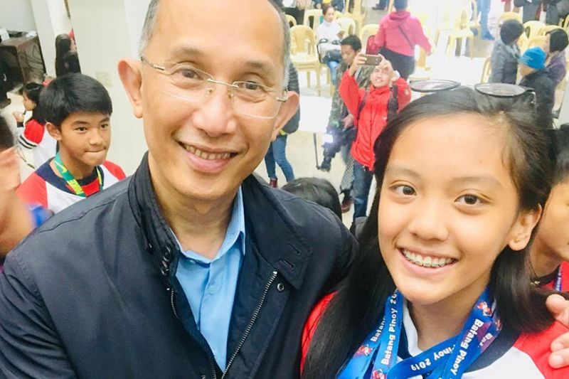 BAGUIO. Batang Pinoy triple gold medalist wushu taulu sensation Aleca Breana Dumseng is congratulated by Mayor Benjamin Magalong during Monday's flag raising ceremony. (Contributed photo)