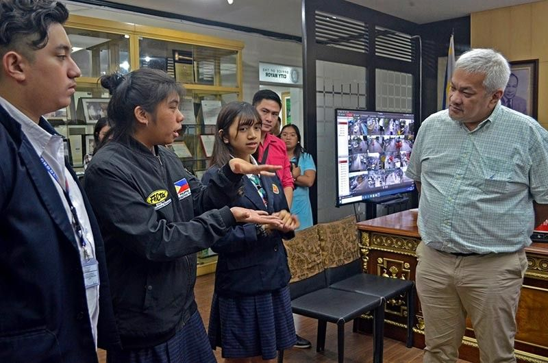 "PAMPANGA. Angeles City Mayor Carmelo ""Pogi"" Lazatin, Jr. commends Team Nexus members Krischell Anne Faust, Amelia Fernandez, and Paolo Palanisamy of Living Stone International School who placed fourth in the recent World Robot Olympiad Friendship Invitational (WROFIT) 2019 in Denmark. (Photo by AC-CIO)"