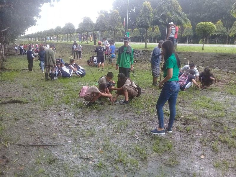 CAPAS, TARLAC. Students volunteer during the tree planting activity of the DND at the Capas National Shrine in line with its 80th anniversary celebration. (Contributed photo)