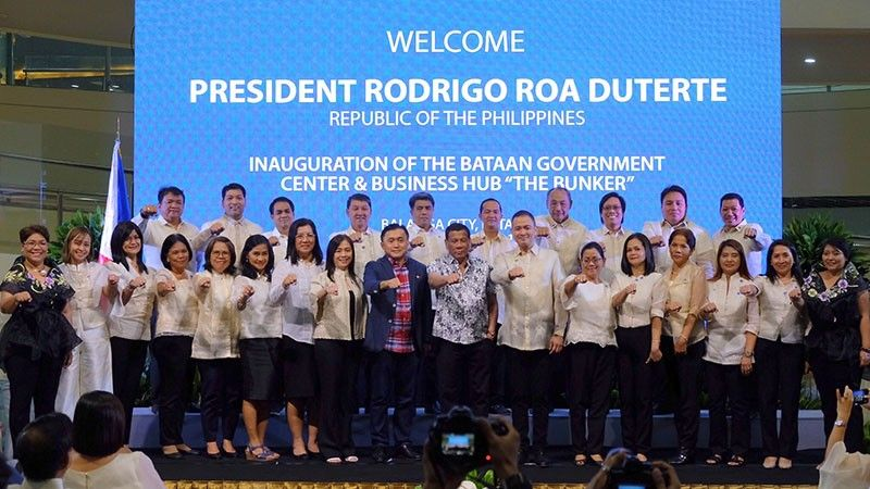 "BATAAN. Representatives of National Government Agencies join President Duterte in flashing the 'fist' sign during the recent inauguration of the new Bataan Government Center and Business Hub or ""The Bunker"", one of the few success stories of PPP in the country. (Photo by Mar Jay Delas Alas/PIA-Central Luzon)"