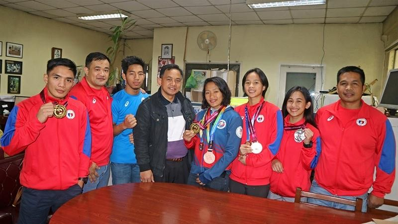 "BAGUIO. Councilor Benny Bomogao congratulates Baguio Muaythai kickboxers gold medalists Ariel Lee Lampacan and Jenelyn Olsim; silver medalists Hanzel Bilog and Islay Erika Bomogao while Jane Benidito won the silver and bronze medal during the World Championship series held in Thailand and East Asian Championhips in Hongkong. The Baguio Muaythai Team will represent our country in the upcoming South East Asian Games in Subic, Zambales on December 2-8. With them were the adjudged ""Best Coaches"" Billy Alumno and Edzel Ngina during the events. (Bong Cayabyab)"