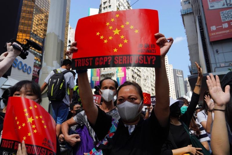 HONG KONG. Protesters hold placards, chanting slogans during a rally on a street in Hong Kong, Sunday, September 15, 2019. Thousands of Hong Kong people chanted slogans and marched Sunday at a downtown shopping district in defiance of a police ban, with shops shuttered amid fears of renewed violence in the months-long protests for democratic reforms in the semi-autonomous Chinese territory. (AP)