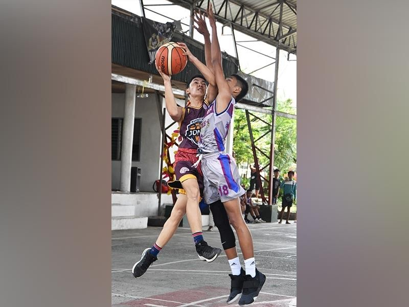 DAVAO. Davao Jones Academy Baby Spunky Jens Buna drives past Immanuel School of Davao defender Daryl Acero in their recent clash at the Davao Youth Games 2019 Inter-School Developmental League at Margarita Village Gym at J.P. Laurel Avenue in Davao City. (Rael Diaz)