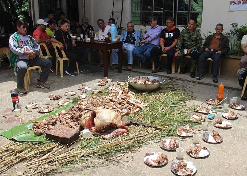 FOR THE DEPARTED. The Municipal Government of Itogon offered prayers and butchered native pigs on Sunday, September 15 marking a year after a landslide hit the town during Typhoon Ompong last year. (Lauren Alimondo)