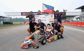 WINNING TEAM. Cebuano karter William John Riley Tiu Go with his coaches and mechanics after winning the overall title in the cadet category. (Contributed Photo/Bong Boado)