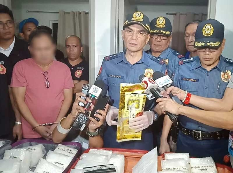 MANILA, National Capital Region Police Office Director Guillermo Eleazar (center) presents the suspect, Manolito Lugo Carlos, and the alleged illegal drugs worth over P200 million recovered from Carlos' condominium unit on Monday evening, September 16, 2019. (Photo from NCRPO)