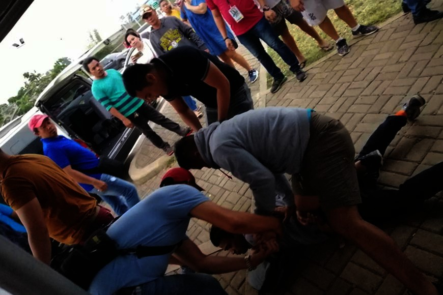 MISAMIS ORIENTAL. Erwin Reginio, 43, of Dasmarinas, Cavite, was pinned down on the ground by cybercrime authorities shortly after his arrest at the Laguindingan airport, Misamis Oriental for allegedly spreading the nude photos of his girlfriend. (Supplied Photo)