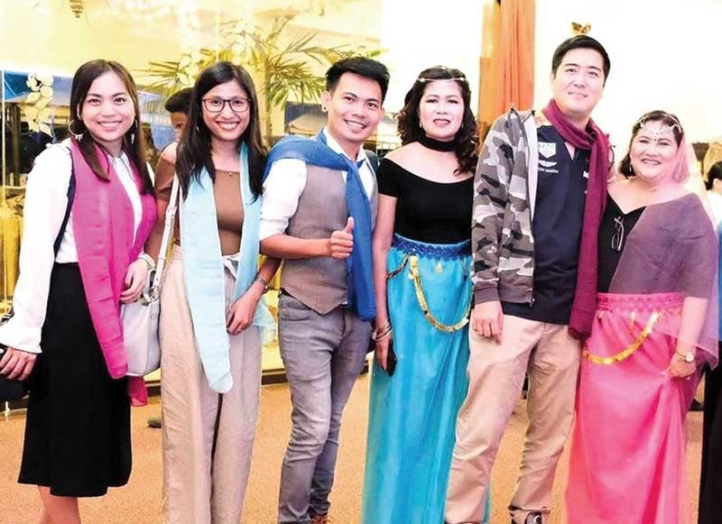 ALL SMILES. From left: Laarni Lucino, Juvy Puno and Joseph Tago of Paradise Cebu Tours; Costabella reservation specialist Andresa Ricablanca; Paradise Cebu president Masashi Nagata and Costabella account officer Rose Flores.