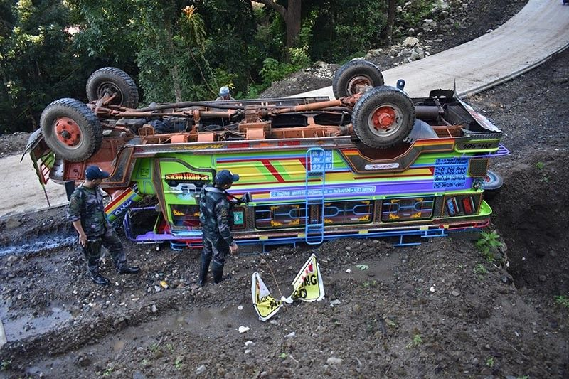 CAUTION. Fourteen persons with two minors were injured in a road crash on Monday at Balluay Road, Balluay, Sablan, Benguet. (Photo courtesy of Sablan Municipal Police Station)