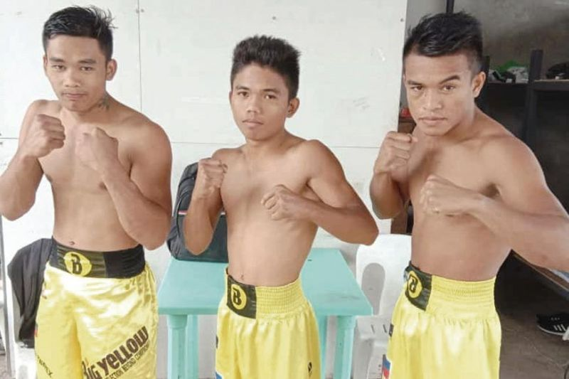 YOUNG FIGHTERS. Elmer Naason, Maurino Agum and Rhonvex Capuloy (from left) will all see action in Danao City next month. (Contributed photo)