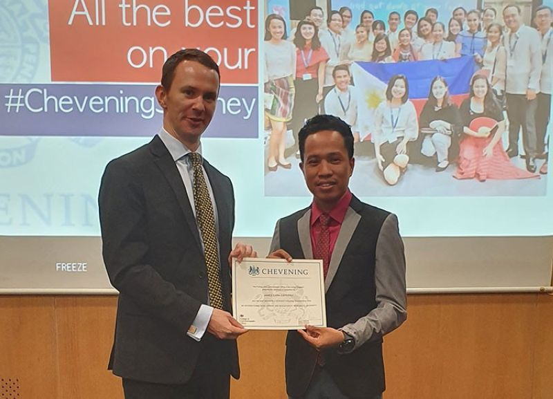 MANILA. British Embassy head of Political and Economic section Iain Cox with Chevening Scholar James Earn Esperida. (Contributed photo)