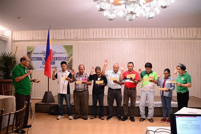 BACOLOD. Parccom chairperson Eduardo Padronia (left) administers the oath taking of the newly-elected sectoral representatives at the Nature's Village Resort in Talisay City on Tuesday, September 17. (Contributed Photo)