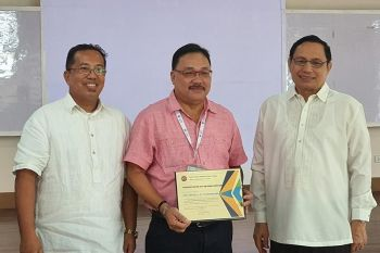 BACOLOD. Dr. Joyzel Rey Garcia, President of the CHMSC Faculty Association President (1st from left) with Dr. Renato M. Sorolla, President of State Universities and Colleges (SUC) III award the Certificate of Appreciation to Dr. Ernel Tumimbang, Negros Occidental Provincial Health officer as one of the Resource Speakers during the symposium. (Photo by Carla N. Cañet)