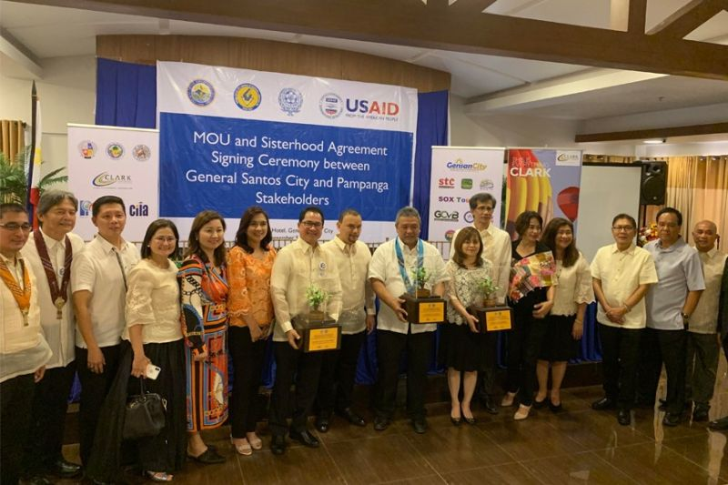 Officials of the Metro Angeles Chamber of Commerce and Industry, Inc., Pampanga Chamber of Commerce and Industry, Inc., Clark Investors and Locators Association and General Santos City in posterity after signing the Metro Clark Area and South Cotabato sisterhood agreement. (Contributed photo)