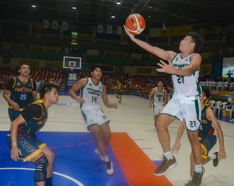 University of the Visayas's Albert Sacayan delivers a lay-up as three of the University of Southern Philippines-Foundation (USPF)'s high school squad attempts to secure the basket during the high school division of this year's Cesafi basketball tournament. Sacayan would eventually lead the Baby Lancers to a 96-69 win against the Panthers. (SunStar photo/ Arni Aclao)