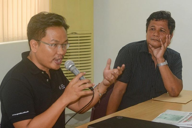SPEAKERS. Fr. Ramon Echica (right), CCPC board member, and Jason Baguia, University of the Philippines journalism professor, discuss how media can fight fake news and disinformation during a forum Thursday, Sept. 19, 2019. (SunStar photo / Arni Aclao)