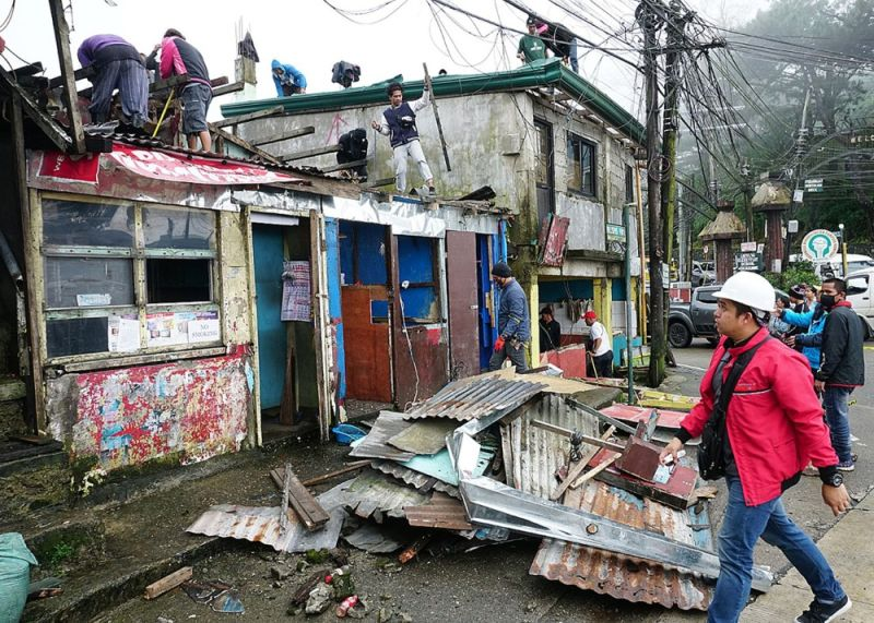 BENGUET. Some 37 out of 267 structures were demolished along Marcos Highway on Thursday in compliance to President Rodrigo Duterte's order during his 4th State of the Nation Address (Sona) last July. (Photo by Jean Nicole Cortes)