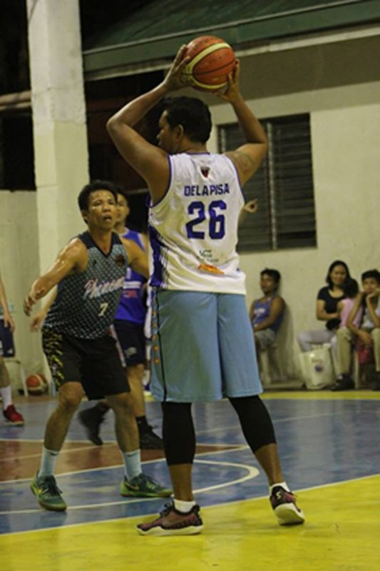San Remigio's Randy dela Pisa tries to get past the defense of the Spartans. (Contributed photo)