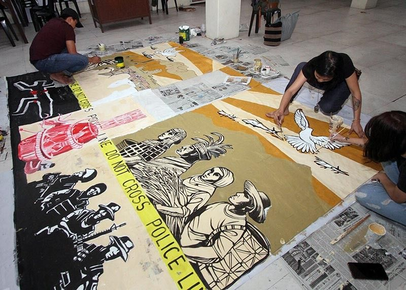 BAGUIO. More than a dozen artists with National Artist for Visual Arts Ben Cabrera collaborated on an art piece which served as a back drop during the Human Right Summit at University of the Philippines - Baguio to commemorate the declaration of martial law in 1972. (Photo by Jean Nicole Cortes)