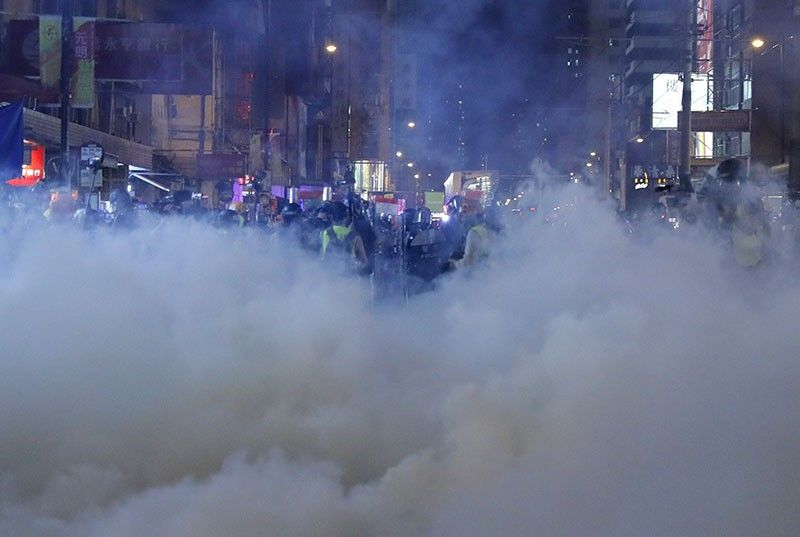 Tear gas fills the street as protesters continue to battle with police on the streets of Hong Kong on Saturday, September 21, 2019. Protesters in Hong Kong threw gasoline bombs and police fired tear gas Saturday in renewed clashes over anti-government grievances (AP Photo)