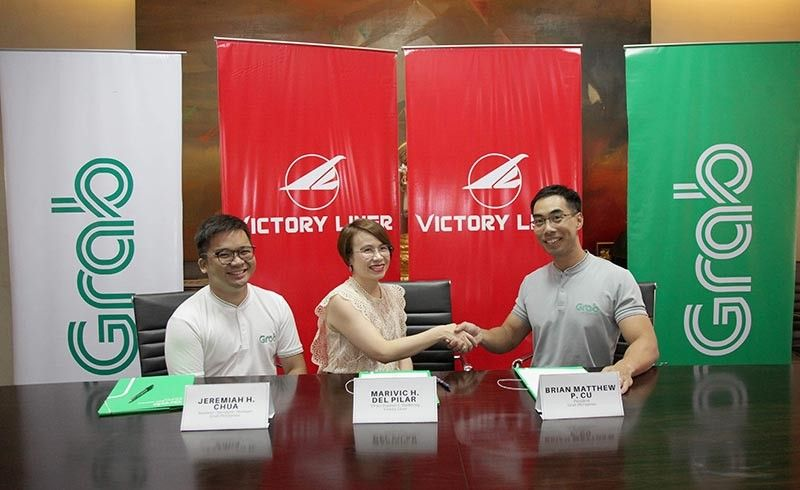 PAMPANGA. Marivic del Pilar, Victory Liner vice president for Treasury and Marketing, Grab Philippines Chief Operating Officer Brian Cu and  Grab Business Development manager Jeremiah Chua sign a landmark partnership that could eventually become a model even to other Point-to-Point bus services in northern and Central Luzon. (Contributed Photo)