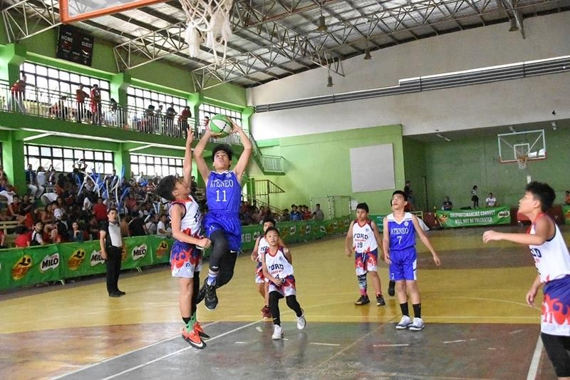 DAVAO. Jake Brendan Alpapara of Ateneo de Davao University shoots against a Ford Academy of the Arts (FAA) defender during the SBP championship game of the 34th Best Center Davao SBP-Passerelle Twin Tournament 2019 held Saturday at Barangay Mintal Multi-purpose Gym. (Best Center Sports Davao Facebook)