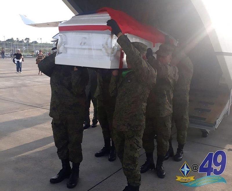 CAGAYAN DE ORO. Members of the Army's 4th Infantry Division carry the casket of Kagay-anon cadet Darwin Dormitorio who died of hazing in the Philippine Military Academy. (Photo courtesy of 4ID)