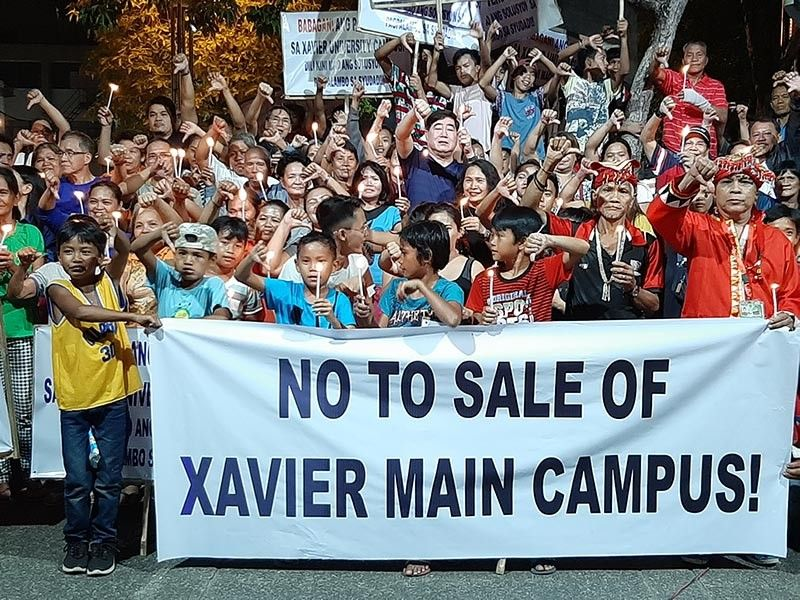 CAGAYAN DE ORO. Concerned parents, teachers, and alumni of the Xavier University held a rally on Saturday, September 21, at Magsaysay Park to protest the sale of its campus in Divisoria. (Alwen Saliring)