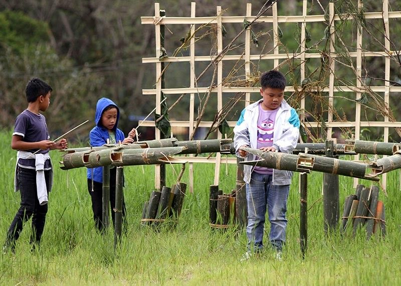BAGUIO. Children play with bamboo installations on display at Ibaloi Park in Burnham as part of the annual Bamboo Festival. (Photo by Jean Nicole Cortes)