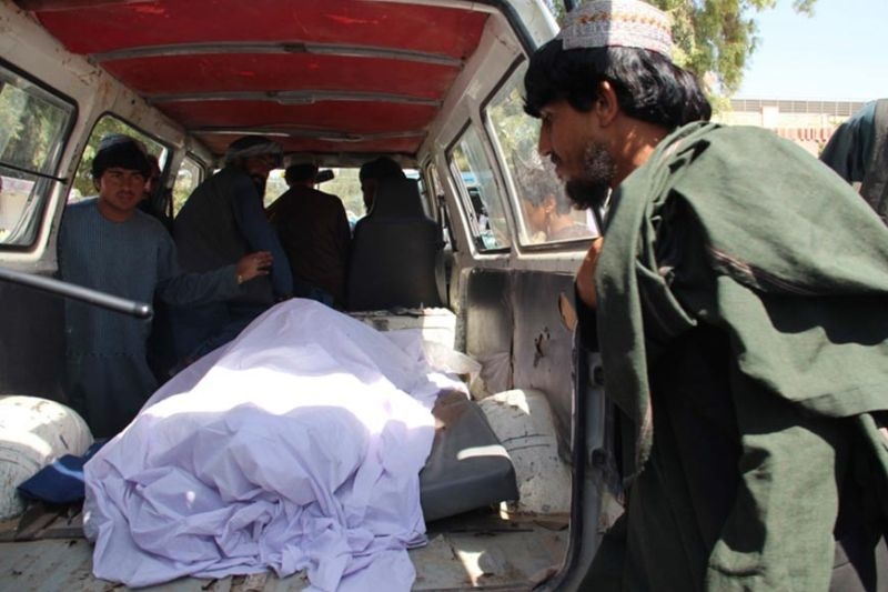 AFGHANISTAN. Afghans transport the body of a woman who was killed during a raid conducted by Afghan special forces, in the southern Helmand province, Monday, September 23, 2019. An Afghan official said Monday that at least 40 civilians have been killed during an Afghan special forces raid and airstrikes conducted against of Taliban in southern Helmand province. (AP)