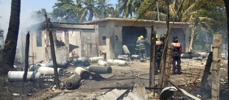 Tanks containing liquefied petroleum gas (LPG) and burnt butane canisters were found by firefighters after a fire hit a house in Sitio Dawis, Barangay San Roque in Talisay City at noon today, September 24, 2019. Firefighters suspected that the house that caught fire may have served as a butane refilling station. (SunStar photo/ Fe Marie Dumaboc)