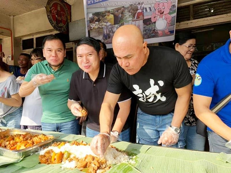 PAMPANGA. Mayor Crisostomo Garbo, Vice Mayor Gerald Aquino and Councilor Marcos Castro lead a boodle fight Tuesday, September 23, 2019, to negate reports about the presence of African Swine Fever in Mabalacat City. (Contributed photo)