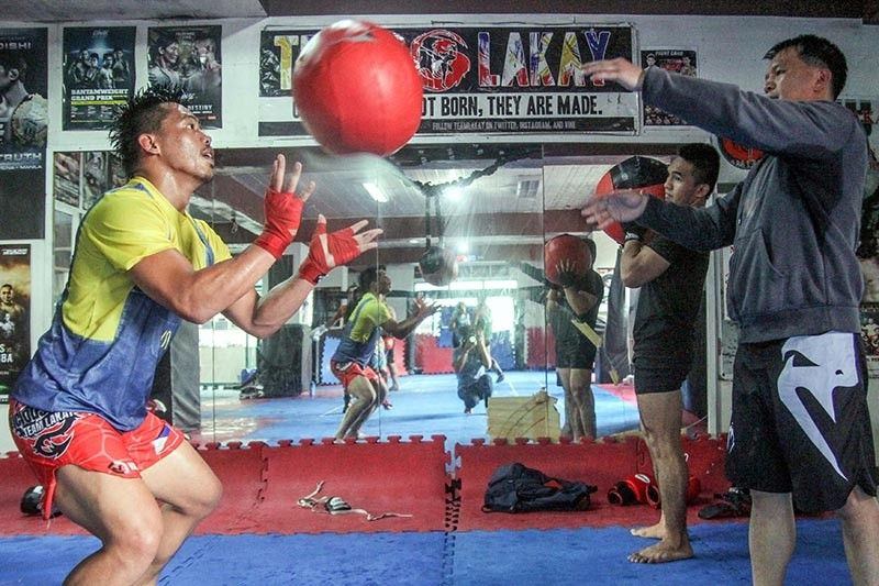 BAGUIO. Honorio Banario is all out during training at the Team Lakay gym with coach Mark Sangiao as they gear up against Shinya Aoki. (Photo by Jean Nicole Cortes)