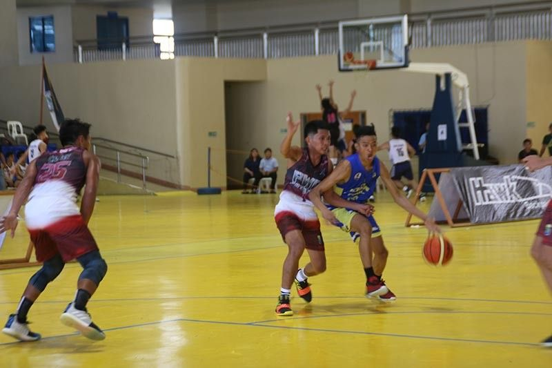 DAVAO. A Philippine Women's College of Davao player, left, defends a John Paul II College of Davao Saints dribbler in their Dacs Sportsfest 2019 college basketball game at the Ateneo de Davao University Jacinto Gym Tuesday afternoon, September 24, 2019. (Marianne L. Saberon-Abalayan)
